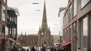 A report shows that in the Church of England there were 390 people who were either members of the clergy or in positions of trust associated with the church had been convicted of sexual offences against children. In this picture, Shoppers walk in front of St Martin's church outside the Bullring Shopping center in Birmingham, UK.(Bloomberg)