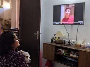 Shipra Dubey, 30, a resident of Delhi, watches a birthday video greeting from singer Shaan, gifted to her by her husband in September.(Abhinay Dubey)