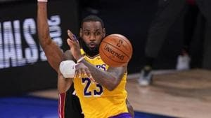 Los Angeles Lakers forward LeBron James passes against the Miami Heat during the second half in Game 4 of basketball's NBA Finals.(AP)