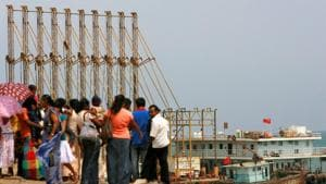 A group of Sri Lankan visitors at the new deep water shipping port watch Chinese dredging ships work in Hambantota, 240 km (150 miles) southeast of Colombo.(REUTERS FILE)