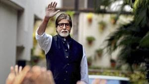 Amitabh Bachchan waves to his fans at his residence in Mumbai.(PTI)