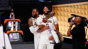 Los Angeles Lakers forward LeBron James (23) and forward Anthony Davis (3) celebrate during the fourth quarter in game six of the 2020 NBA Finals at AdventHealth Arena.(USA TODAY Sports)