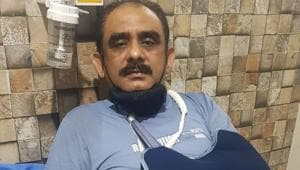 Mahesh Khulbe, who is a member of the BJP's state working committee, had to be hospitalised for treatment after his arm was fractured in the incident.(HT PHOTO.)
