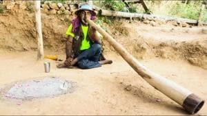 Late Mukesh Dhiman playing Didgeridoo at his residence in Rishikesh.(HT Photo)