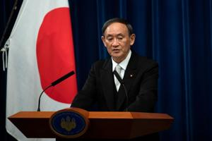 FILE PHOTO: Yoshihide Suga speaks during a news conference following his confirmation as Prime Minister of Japan in Tokyo, Japan September 16, 2020. Carl Court/Pool via REUTERS/File Photo)