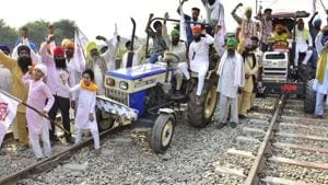 Farmers protesting on tractors along railway line during the ongoing 'Rail Roko' or 'Stop the Trains' protest against the new agriculture laws in Amritsar earlier this week.(HT Photo)