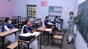 Students attending a class at Government Girls Senior Secondary School in Bathinda on Monday, seven months since the Covid-19 lockdown.(Sanjeev Kumar/HT)