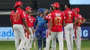 Kings XI Punjab players during the Indian Premier League (IPL) T20 cricket match against Mumbai Indians (MI), at Dubai International Cricket Stadium in Dubai.(PTI)