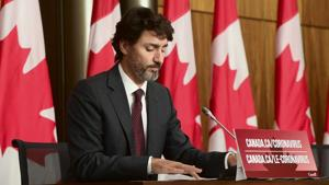 Canadian Prime Minister Justin Trudeau listens to a question as he takes part in a press conference in Ottawa on October 13.(AP)