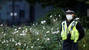 A police officer wearing a protective mask looks on, amid the outbreak of the coronavirus disease, in Manchester, Britain.(REUTERS)
