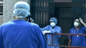 File photo: Doctors admitting Covid-19 patient.(Dheeraj Dhawan/Hindustan Times)