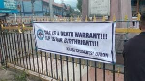 Posters being put up by activists of the Khasi Students' Union in Shillong on Wednesday.(HT Photo)