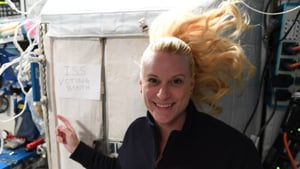 """The post featured a photo of Rubins, her hair floating in the zero-gravity environment, in front of an enclosure with a sign that reads """"ISS voting booth"""".(NASA/Twitter)"""