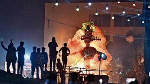 An effigy of Ravana in flames during one of the permitted celebrations in Karkardooma on Sunday.
