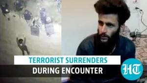 Watch: Hizbul terrorist surrenders during encounter; reunited with family