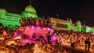 Devotees light earthen lamps on the bank of Saryu River during Deepotsav celebrations in 2019.(PTI FILE)