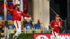 Chris Gayle of Kings XI Punjab celebrates after taking a catch for the dismissal of Nitesh Rana of Kolkata Knight Riders during their Indian Premier League (IPL) cricket match in Sharjah.(PTI)