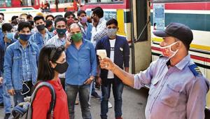 A passenger is screened at Anand Vihar ISBT.(Raj K Raj/HT photo)