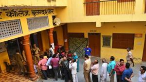 Voters stand in a queue to cast their votes in this file photo in Uttar Pradesh's Bulandshahr.(HT Photo/Vipin Kumar)