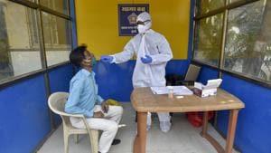 Healthcare workers during a Covid-19 screening and swab test at Samta Nagar police station,Kandivali (E) in Mumbai .(Satyabrata Tripathy/HT Photo)