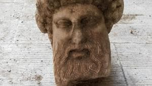 In this undated photo, provided by the Greek Culture Ministry on Sunday, Nov. 15, 2020, a head of the ancient god Hermes is pictured after being found during sewage works in central Athens. The ministry said Sunday that the head, depicting Hermes at a