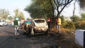 The charred remains of the car after it collided with a Canter and caught fire on Sunam road on the outskirts of Sangrur town on Monday night.(HT Photo)