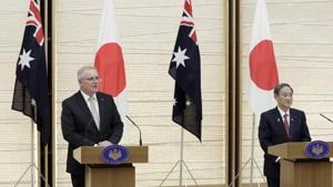 Scott Morrison, Australia's prime minister, left, speaks while Yoshihide Suga, Japan's prime minister.(Bloomberg)