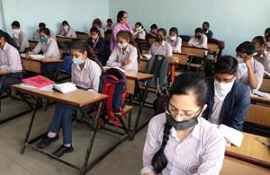 Students attending a class at a government school in Rohtak district last week. The school education department has directed all district education officers to ensure sanitisation of schools.(Manoj Dhaka/HT)