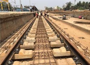 Track laying work going on at Yog Nagri-Veerbhadra railway station in Rishikesh.(HT Photo)