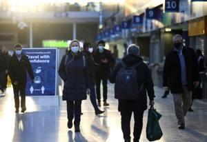 People walk through Waterloo station, amid the coronavirus disease outbreak, in London on November 23.(REUTERS)