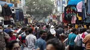 A massive crowd of people shopping while violating social distancing norms after the Covid-19 outbreak, in Sarojini Nagar market in New Delhi on Sunday.(ANI Photo)