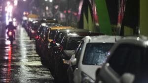 Residents park their vehicles on a flyover before the landfall of Cyclone Nivar, at Velachery in Chennai.(PTI)