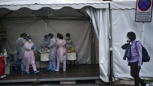 Mbaye Babacar Diouf, right, walks by a special coronavirus checkpoint, at Basurto hospital, in Bilbao, northern Spain, Wednesday, Nov. 18, 2020. Mbaye Babacar Diouf's life as a migrant in Europe took a turn for the better when he was adopted in Spain at the age of 28. That enabled him to pay his debts to human traffickers, study nursing and find a job at a Spanish hospital. Now he's giving back to the community. In a Bilbao hospital he cares for COVID-19 patients.(AP)