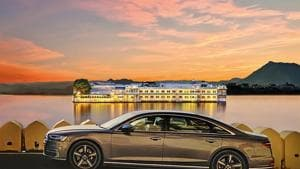 The Audi A8 looks perfectly at home set against the magnificent Taj Lake Palace in Udaipur