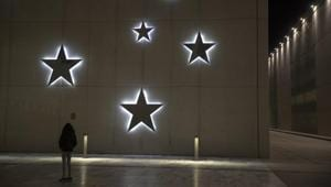 A child look at Christmas decoration at the Stavros Niarchos Foundation Cultural Center, in Athens.(AP)