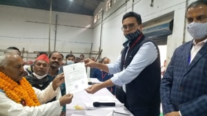 Assistant returning officer Navneet Singh Chahal handing over the certificate of victory to newly elected MLC Lal Bihari Yadav in Varanasi on Friday.(HT PHOTO)