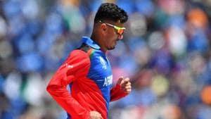 Afghanistan's Mujeeb Ur Rahman walks back to his fielding position.(AFP)