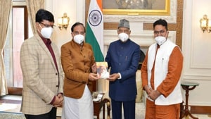 """Ramesh Pokhriyal presenting the first copy of his book """"Pioneer of Humanity: Maharshi Arvind"""" to President Ram Nath Kovind.(ANI)"""