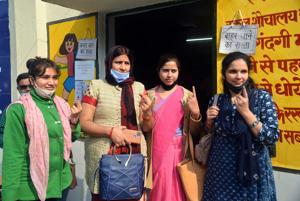 People show their ink marked fingers after casting their votes for the MLC elections in Varanasi.(ANI)