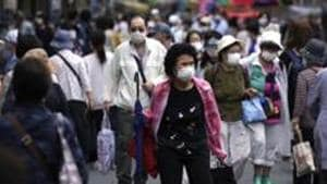 Despite some signs of improvement in recent months, analysts expect Japan's economy to shrink 5.6% in the current fiscal year ending in March 2021 and say it could take years to return to pre-coronavirus levels.(AP file photo)