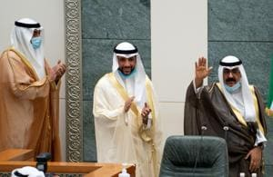 Kuwait's newly appointed crown prince Sheikh Meshal al-Ahmad Al-Jaber al-Sabah waves before he is sworn in, as speaker of parliament Marzouq al-Ghanim, and Kuwait's Prime Minister Sheikh Sabah al-Khalid al-Sabah clap, at the parliament, in Kuwait City.(Reuters)