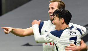 Tottenham Hotspur's English striker Harry Kane (L) celebrates scoring his team's second goal with Tottenham Hotspur's South Korean striker Son Heung-Min(Getty Images)