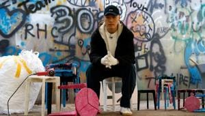 Kim Ha-neul, who is majoring in furniture design, poses for photographs with his upcycled stools made from discarded protective masks in Uiwang, South Korea.(REUTERS)