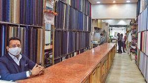 Khan Market's Grover Tailors, which had earlier stitched for foreign dignitaries, including presidents, has suffered an 80% drop in business.(Amal KS/HT PHOTO)