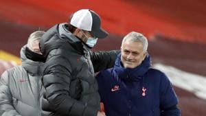 Liverpool manager Jurgen Klopp, left, interacts with Tottenham Hotspur manager Jose Mourinho after their English Premier League soccer match between Liverpool and Tottenham Hotspur at Anfield in Liverpool, England, Wednesday, Dec., 16, 2020.(AP)