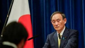 In Japan, fiscal reform has been shelved as Prime Minister Yoshihide Suga prioritised efforts to contain the pandemic and boost growth, despite public debt at more than twice the size of Japan's $5 trillion economy.(POOL)