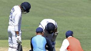 India's Mohammed Shami, second right, is attended to by medical staff after he was struck on the forearm on the third day of their cricket test match against Australia at the Adelaide Oval in Adelaide, Australia, Saturday, Dec. 19, 2020. (AP Photo/David Mairuz)(AP)