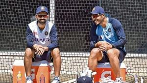 India captain Ajinkya Rahane (L) chats with Umesh Yadav during a training session ahead of the second Test in Melbourne.