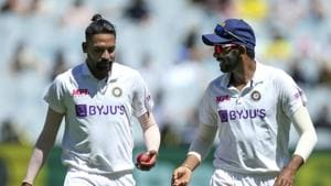 Melbourne : India's MD Siraj, left, and Jasprit Bumrah chat during play on day one of the Boxing Day cricket test between India and Australia at the Melbourne Cricket Ground, Melbourne, Australia, Saturday, Dec. 26, 2020.(AP)