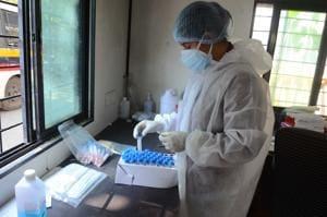 A staff member at Rukminibai hospital in Kalyan arranges Covid-19 testing kit.(Rishikesh Choudhary/HT Photo)